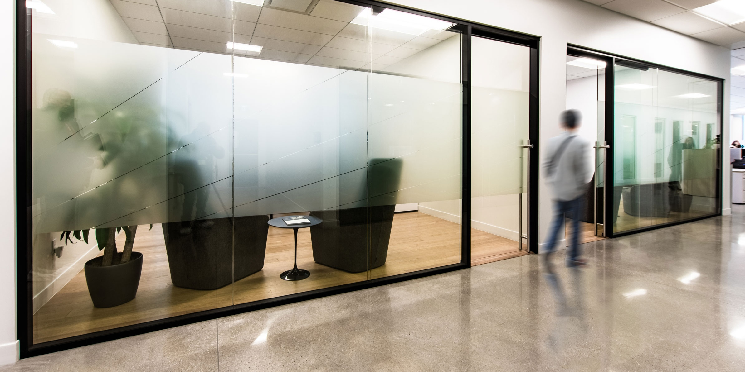 Man walking past two offices with Starwall walls