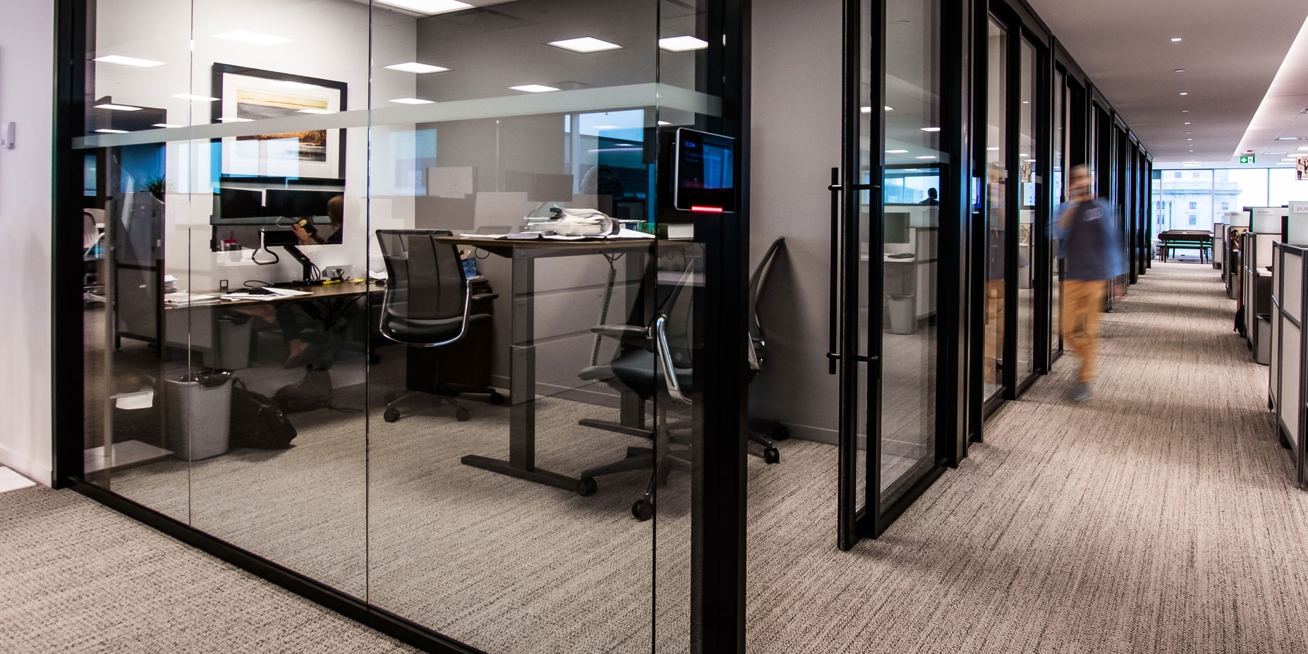 Glass walls surrounding office areas