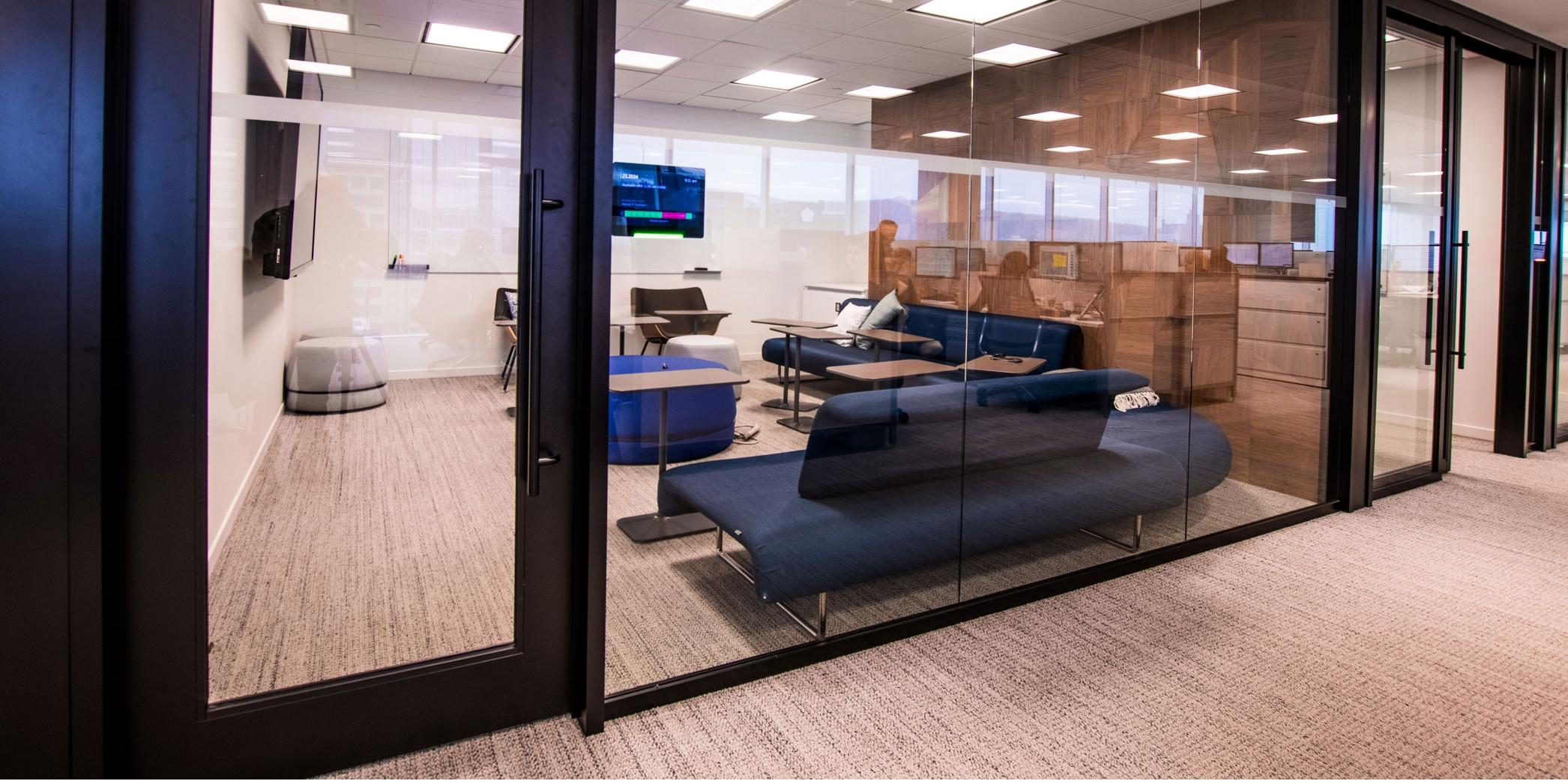 Glass walls surrounding break room